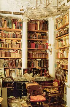 This is a classy messy home library... reminds me of harry potter or something