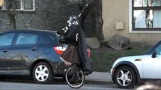 Darth Vader on a unicycle playing bagpipes.