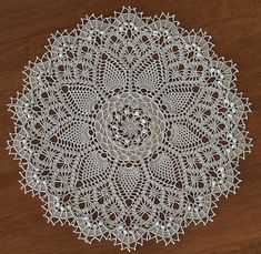 """""""Pineapple Song"""" from Leisure Arts """"Absolutely Gorgeous Doilies"""" by Patricia Kristoffersen  DMC Cebelia Crochet Cotton, Size 10 color: #712 Cream  17-1/2 inches using a size 6 (1.80mm) steel crochet hook"""