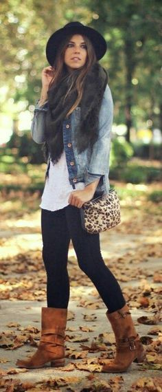 Light jean jacket, long white shirt, black scarf, faux fur vest with brown boots. Another great outfit to try this winter!
