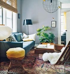 Living room colors!!! I like the black lamp, black and white pillow, sheepskin, yellow pillow and PLANT, plus i think the deep gray turquoise would be perfect High Street Market: Hello, Fiddle Leaf Fig!