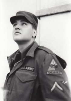 This is an previously unpublished snapshot of Private First Class Elvis Presley by 15-year-old German teenager Anita Stawarz, Bad Nauheim, Germany, between March and June 1959. Anita Stawarz was not an Elvis fan but an autograph hunter, then living in Frankfurt, who came together with her girlfriends more than ten times to Bad Nauheim in 1959 (the first time in March) to get as many Elvis autographs and take as many photos as possible.