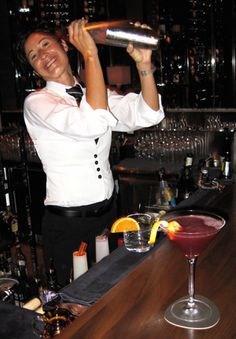 At the free standing Tavern Bar at Michael Mina's Stonehill Tavern, Nicole McGregor, who has been with the restaurant since it opened as Aqua in 2001, shakes up a Ward Eight cocktail made with Knob Creek, having just finished a Pomegranate Cosmo in the foreground. Obviously, she enjoys her work.