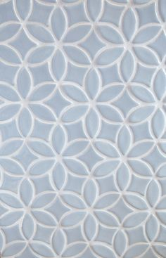 Handmade tile can add a unique touch to your kitchen or bathroom renovation. Seen here is our Bloom pattern in Light Gray | juleptile.com