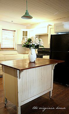 The Virginia House: Old Dresser = Kitchen Island @katie Whipple for your kitchen. I love that light!