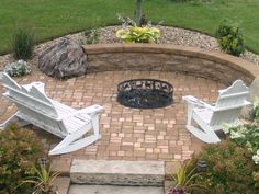 Design Fire Ring. This beautiful Firepit patio area with seat wall was created using precast block to line the walls of the pit below ground.  The fire ring was then placed down in the pit to give this setting a more elegant look.