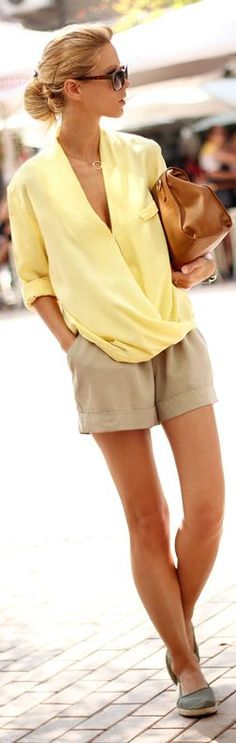 Summer look, Pastel yellow fold blouse, neutral shorts and flats