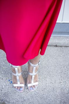 Metallic sandals are a perfect match for a bright red skirt