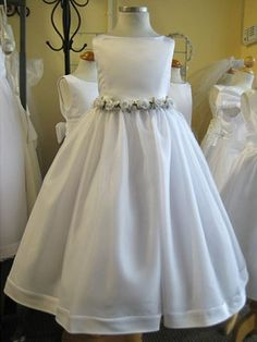 white hand rolled rosettes dress