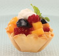 """Print Recipe Ingredients: 1 mango, fresh, ¼"""" diced 2 strawberries, medium size, ¼"""" diced 5 raspberries, quartered 6 blueberries, quartered 2 teaspoons orange juice 1½ teaspoons agave syrup 4 mint leaves, chopped, approx. ½ teaspoon 1 package (15 count) Athens® Mini Fillo Shells Whipped topping, fat free, for garnish Directions: In a medium bowl, combine …"""