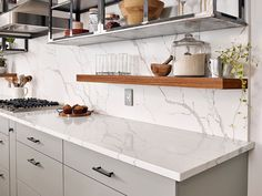 Calacatta Laza Quartz white quartz countertops feature a soft white background and soft brown veins reminiscent of natural marble. Durable, easy to clean, and maintenance free, use this gorgeous slab to create show-stopping countertops, kitchen islands, floors, backsplashes, and accent walls.
