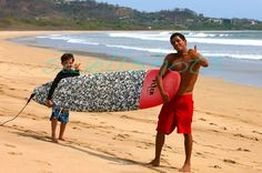 Surfing is always fun...even when the board is twice your size.