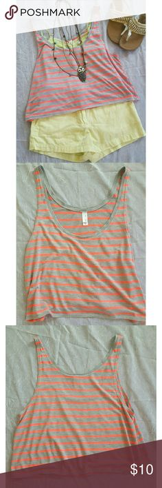 Striped Boxy Tank This is a loose cropped tank that's great for layering! Excellent condition. I have tons of this style/brand of tank that I have put designs on so never wore this one. Super cute for layering to the gym as well! Grey/neon pink or neon coral - can't decide! bella Tops Crop Tops