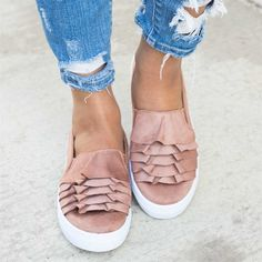 Get the look in this faddish-styled ruffle slip-on sneakers that are made for style and comfort with easy on and off wear!