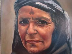 Portrait of an elderly Yazidi Woman with traditional Face These people are an old religion that cares for the earth and doesn't cause anyone any problem yet the Arabs are mean to them.