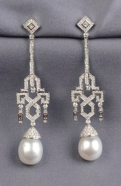 18kt White Gold, South Sea Pearl, and Diamond Earpendants, each set with princess-, full-, and baguette-cut diamond melee, approx. total wt. 3.00 cts., suspending a pearl measuring approx. 13.50 mm, lg. 3 1/4 in.