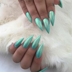 mint green holographic stiletto nails