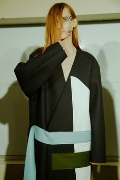 Double face and wrap coat at Jacquemus AW15 PFW. See more here: http://www.dazeddigital.com/fashion/article/23932/1/jacquemus-aw15