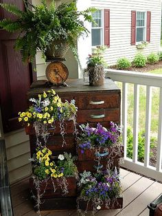 Wow, look at this beautiful display in an old dresser.  What is that on top, is that an old flour sifter?