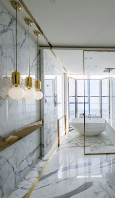 Marble bath with gold accents. Beautiful!