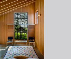 Sliding barn doors to screen lower part of tall window -- Turnbull Griffin Haesloop Architects