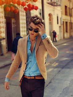 the rugged nature of the light blue denim shirt paired against the classic and sophisticated texture of the khaki tweed blazer