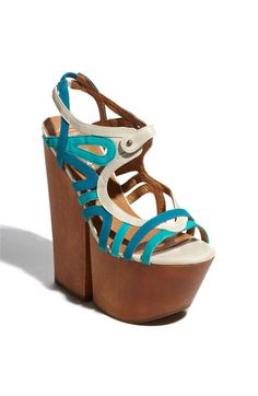 "the 1970's are back!!!! 2012 Jeffrey Campbell 'Follie' Sandal, in  the Ivory Blue Green version, very pretty. ""Pop-art straps paint colorful retro-chic across a push-pin sandal sent sky-high by a stunningly tall platform and heel."" these nude colored chunky platform sandals have a 7"" heel with a 3 1/4"" platform, comparable to walking in a 3 3/4"" heel, not so high after all!!!!   $154.95  i love these, i can see this as more British fashion than American. stupid americans."