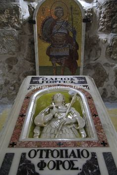 Israel, Lod, tomb of St. George at the Greek Orthodox Church of St. George, the top is covered with olive oil on the Day of Saint George
