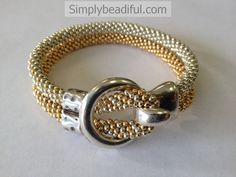 Kumihimo Ring Hook Metallic Bracelet Kit This kit contains enough silver and gold finished seed beads to create this beautiful metallic bracelet, along with the two-holed bead and ring hook clasp in a silver finish. Micro C-Lon cord is also included along with Sally Battis' Blended pattern with our adjusted instructions in order to turn …