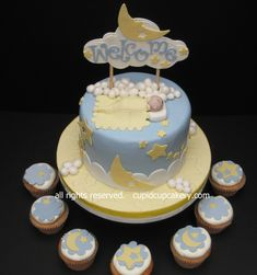 Stars & Moon Baby Shower Cake & Cupcakes Moon, star and clouds baby shower cake in vanilla bean. Baby sleeping in the clouds,...