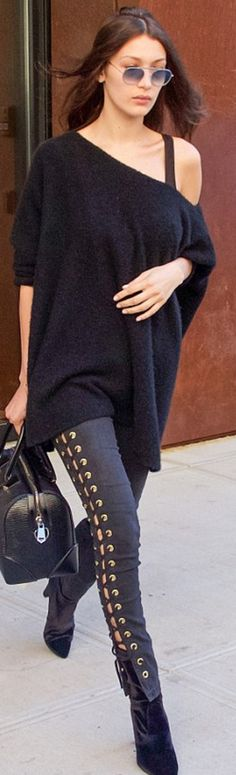Who made  Bella Hadid's black lace up jeans, velvet boots, key chain, and leather handbag?