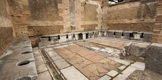 The Etruscans laid the first underground sewers in the city of Rome around 500 BCE. And the Romans were happy to utilize them when they took over the city. Such structures then became the norm in many cities throughout the Roman world.