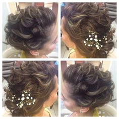 Romantic, soft, elegant updo. Perfect curls with some baby breaths as a simple yet cute style. Perfect for a wedding.