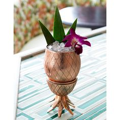 The pineapple has long been recognized as a symbol of hospitality and warm welcome. Welcome others to your home with this two-piece brass pineapple tumbler, a unique serving piece for a well-crafted c