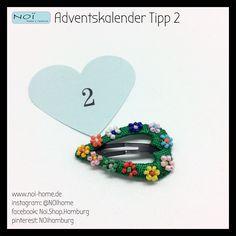 #Adventskalender #Tipp 2: #Hairclip mit Blüten aus #Perlen. Handgearbeitet und absolut cute. Kleine Geschenke von NOI - 24 Tage jeden Tag eine neue Idee. Besucht uns im #Schanzenviertel in #Hamburg oder online :).