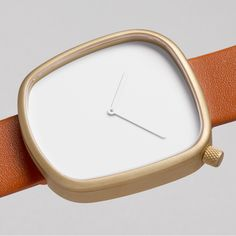 Pebble watch in white/gold designed by KiBiSi for bulbul. Available at Dezeen Watch Store: www.dezeenwatchstore.com #watches