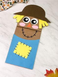 This brown paper bag scarecrow puppet is a fun fall craft for kids in preschool, kindergarten and elementary! #simpleeverydaymom #kidscrafts #preschool #elementary #fallcrafts #autumncrafts #kidsactivities