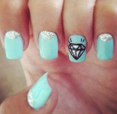 Simple nail design with the ring finger with a diamond!