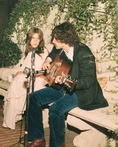 Stevie Nicks and Lindsey Buckingham performing at a wedding, 1971