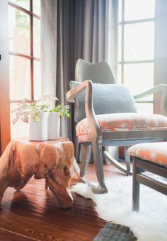 Vintage Rocking Chair and Natural Wood Side Table- love these rustic accents!