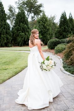 Beautiful bride Julie in her Lyon gown by Anne Barge.  The silk white wedding dress has a strapless bodice accented by lace appliques and a skirt with box pleats in the back.