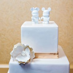 Top your wedding cake with Vinylmations to add just the right amount of Disney magic to a traditional cake