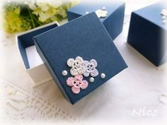 small crochet flowers on the box for cute packaging