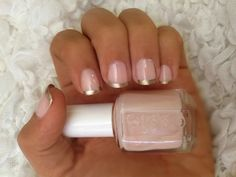 Neutral and gold French tip manicure