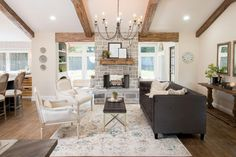 The living room was so large with the sunroom connected, that we had to work out a way to define the two spaces so not a single inch of space was wasted. This double sided fireplace was a great way to bring separation to the space without completely closing it off.