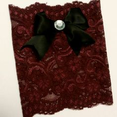 Wine colored lace boot cuffs with classy bow.  Only a few of these left!!!  Www.etsy.com/shop/MostBeautifulDesigns