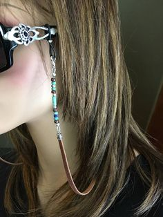 A rustic, beaded Southwest eyeglass chain made with saddle brown deerskin leather, and tribal Czech glass beads in turqu Eyeglass Holder, Deer Skin, Bijoux Diy, Eye Glasses, Czech Glass Beads, Designer, Eyewear, Earth Tones, Bracelet