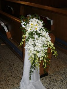 Wedding Pew and Chair Flower Decorations and Bows.