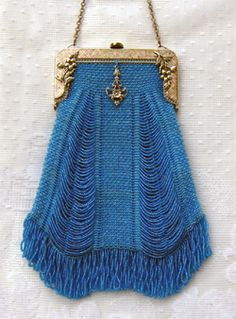 I covet this victorian purse. But the best thing about it? I can make one with a pattern from Victorian Purses by Sue.