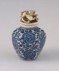 Chinese Snuff Bottle   Qing Dynasty (1644-1911), 19th century  Artist/maker unknown,   Porcelain with underglaze blue and white decoration; ivory stopper  2 x 1 1/2 inches (5.1 x 3.8 cm)